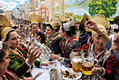 Women wearing the traditional golden hats, Oktoberfest, Munich, Bavaria, Germany