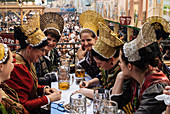 Women wearing the traditional golden hats, Oktoberfest, Munich, Bavaria, Germany