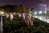 Statues At The Korean War Memorial During Night In Washington Dc