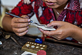 An Indonesian woman makes silver jewelry by hand in her studio in Ubud, Bali.