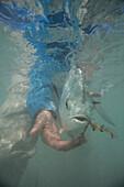 Releasing a permit underwater on a windy day. Cayo Cruz, Cuba.