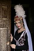 Traditionally Dressed Uzbek Woman Performer at the Toshhovli Palace in Khiva Uzbekistan