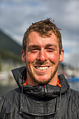 Portrait Of Smiling Member Of Team During The Race To Alaska