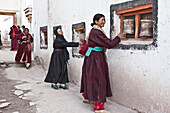 Ladakhi Women Turning Prayer Wheels At Hemis Monastery