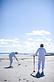 A group of people playing croquet in a beach tournament on Higgins Beach near Portland, Maine