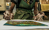 'Close up of the paint-covered hands of a Cuban painter signing his work and holding a cigar in El Taller Experimental de Gr?ífica (Experimental Graphic Studio''), a cooperative graphic print shop and art studio in Old Havana or Habana Vieja, La Habana, C