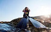 Women Preparing For Diving In Petit Perello Cove