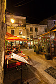 Night view of the typical alleys and restaurants of the old town Porto Vecchio Corsica France Europe