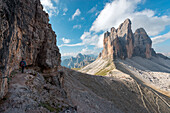 Europe, Italy, Dolomites, Veneto, Belluno, Hiker admire Tre Cime di Lavaredo from Trenches of the First World War on Mount Paterno
