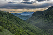 Apennines and Umbrian backcountry at sunrise in a stormy day, Umbria, Italy