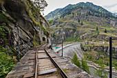 The rails towards the dam of Lago Campliccioli, Valle Antrona, Piedmont, Italy