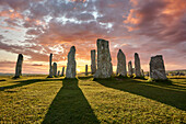 Calanais Standing Stones central stone circle, at sunset, erected between 2900-2600BC measuring 11 metres wide At the centre of the ring stands a huge monolith stone 4 8 metres high weighing about 7 tonnes, which is perfectly orientated so that its widest