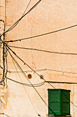 A typical unusual wiring on a house wall, Valldemossa, Mallorca, Spain