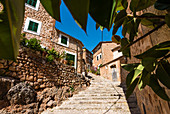 A alley in the picturesque small mountain village in the Tramuntana Mountains, Fornalutx, Mallorca, Spain