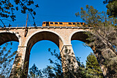 The historical railway between Palma and Sóller crosses a viaduct in the Tramuntana Mountains, Sóller, Mallorca, Spain