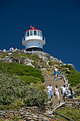 Tourist climbing up and down steps to visit the lighthouse at Cape Point, Cape Town, South Africa, africa