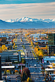 Aerial view of C Street in Anchorage with snow capped Kenai Mountains in the background in autumn, Southcentral Alaska, USA