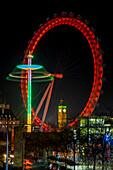 'Millennium Wheel and Big Ben framed at nighttime; London, England'