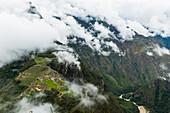 'Aerial view of Machu Picchu Citadel with Urubamba River; Cusco Region, Peru'