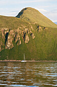 'Sailboat In Front Of Amagat Island Between Morzhovoi Bay And Cold Bay On The Alaska Peninsula; Southwest Alaska, United States Of America'