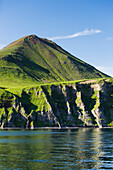'The Pallisade Cliffs In Ikatan Bay Of False Pass, Also Known As Isanotski Strait, In Summertime; Southwest Alaska, United States Of America'