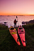 'Kayaks along Atlantic Ocean coastline, Bear Point; Nova Scotia, Canada'