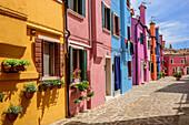 Alley with multi-coloured houses, Burano, near Venice, UNESCO World Heritage Site Venice, Venezia, Italy