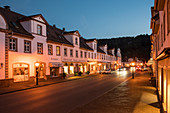 Historic road with houses in Baroque style from the time of the first settlement of the Huguenots at dusk, Bad Karlshafen, Hesse, Germany, Europe