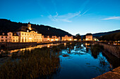 Former packing and storage house, now town hall of Bad Karlshafen at the historic harbor basin at dusk, Bad Karlshafen, Hesse, Germany, Europe