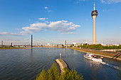 Excursion ship on the Rhine river, view to Rheinknie bridge and television tower, Duesseldorf, North Rhine-Westphalia, Germany