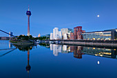 Full moon, television tower and Neuer Zollhof (Architect: F.O. Gehry), Medienhafen, Duesseldorf, North Rhine-Westphalia, Germany