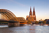 View over the Rhine river to Hohenzollern bridge and Cologne cathedral, Cologne, North Rhine-Westphalia, Germany