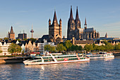 View over the Rhine river to the Old town with town hall tower, Gross-St-Martin church and cathedral, Cologne, North Rhine-Westphalia, Germany