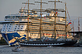 Cruise ship and traditional sailing ship at the Hanse Sail Rostock, Warnemuende, Mecklenburg Vorpommern, Germany