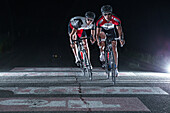 Young men having a race with their racing cycles in the Kitzbühler Alps, Kitzbühlerhorn, Tyrol, Austria