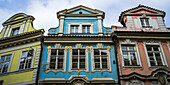 'Low angle view of houses in bright colours and decorative facade; Prague, Czech Republic'