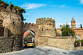 Kakheti, Arch, Gate, Old, Stone, Wall, Entrance, Driving, Yellow, Car, Pedestrian, Blue Sky, History, Remains, Remnants, 18th Century, Fortification, Tower, Watchtower, Sighnaghi, Georgia, Road, Building, , Blue, Sky, 18th, Century, Horizontal, Travel Des