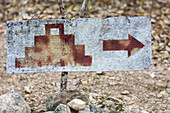 A pictogram and arrow on a wooden board at the Ek Balam ruins, Ek Balam, Yucatan, Mexico