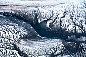 Aerial view of the mountainous landscape in winter with unique branching patterns, Kachemak Bay, Alaska, United States of America