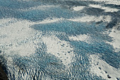 Aerial view of patterns in the snow and ice on the mountains of Fairweather Range, Glacier Bay National Park, Gulf of Alaska, Alaska, United States of America