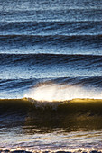 Sunlight reflecting on the surface of the water and waves in Kachemak Bay, Homer, Alaska, United States of America