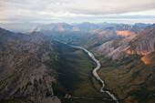 A river running through a valley in a rugged mountain range, Alaska, United States of America