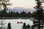 A couple canoeing on Stone Step Lake, Homer, Alaska, United States of America