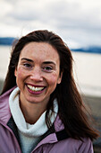 Portrait of a smiling woman with long brunette hair, Homer, Alaska, United States of America