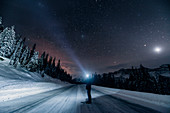 Man on the road at night, Icefields Parkway, Banff National Park, Jasper National Park, Alberta, Kanada, north america