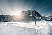 man playing ice hockey at Lake Louise, Bow Valley, Banff National Park, Alberta, Kanada, north america