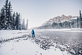 Man standing at Bow River, castle junction, Banff Town, Bow Valley, Banff National Park, Alberta, canada, north america