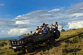 Jeep with persons, game drive, Addo nature park, South Africa