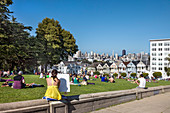 People relaxing in the park, Alamo Square, San Francisco, California, USA