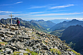 Two persons standing at summit of Aperer Turm, Aperer Turm, Stubai Alps, Tyrol, Austria